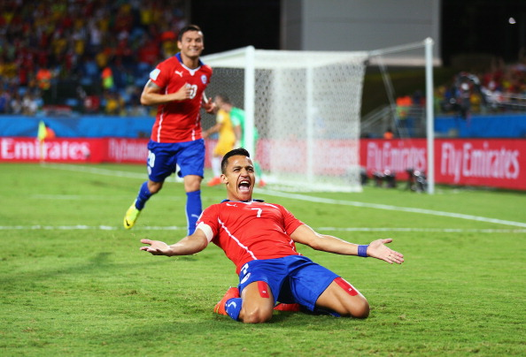 CUIABA, BRAZIL - JUNE 13:  Alexis Sanchez of Chile celebrates after scoring a goal during the 2014 FIFA World Cup Brazil Group B match between Chile and Australia at Arena Pantanal on June 13, 2014 in Cuiaba, Brazil.  (Photo by Clive Mason - FIFA/FIFA via Getty Images)