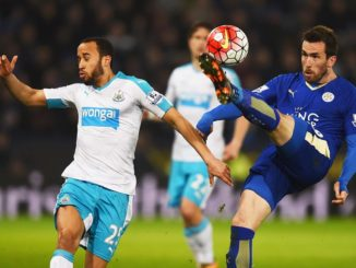 LEICESTER, ENGLAND - MARCH 14:  Christian Fuchs of Leicester City clears the ball from Andros Townsend of Newcastle United during the Barclays Premier League match between Leicester City and Newcastle United at The King Power Stadium on March 14, 2016 in Leicester, England.  (Photo by Laurence Griffiths/Getty Images)