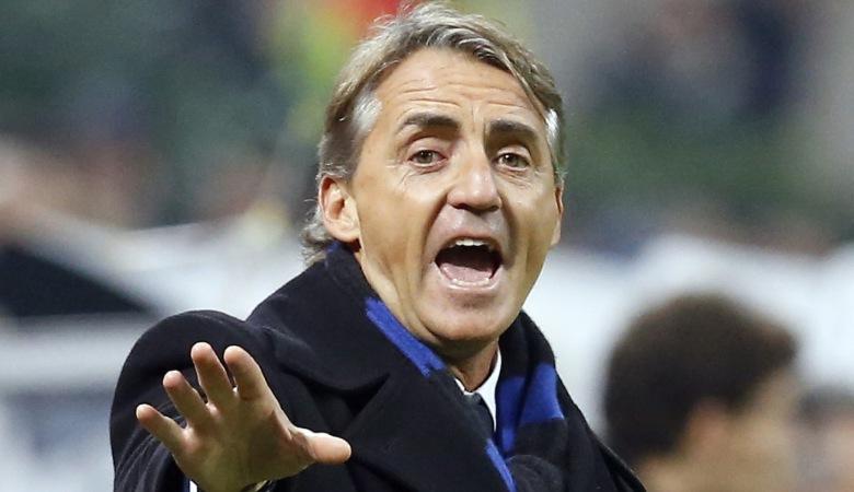 Inter Milan's coach Roberto Mancini gestures during their Italian Serie A soccer match against AC Milan at the San Siro stadium in Milan November 23, 2014.  REUTERS/Alessandro Garofalo (ITALY - Tags: SPORT SOCCER)